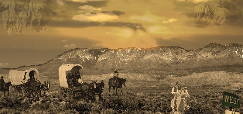Image of frontier wagon train, cowboys and a Native American